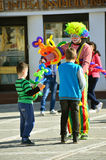 Clown with kids Stock Images