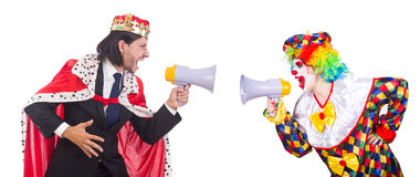 The clown and king with loudspeakers isolated on Royalty Free Stock Photos