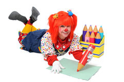 Clown Laying Down Writing Stock Photo