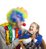 Clown and little girl Stock Images