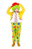 Clown. Little girl dressed as a clown isolated in white stock photography