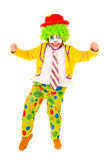 Clown. Little girl dressed as a clown isolated in white royalty free stock images