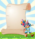 A clown beside a long paper scroll Stock Photography