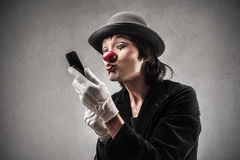 Clown looking himself in the mirror Royalty Free Stock Photos