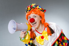 Clown with loudspeaker isolated on white Royalty Free Stock Photos