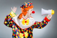 Clown with loudspeaker isolated on white Stock Photos