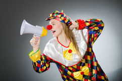 Clown with loudspeaker isolated on white Royalty Free Stock Photography