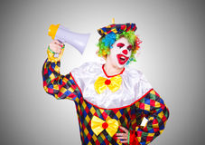Clown with loudspeaker on white Stock Photo