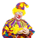 Clown Makes Balloon Animal Stock Image