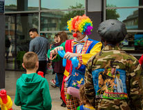 Clown making animals. Bristol, UK - July 16, 2016: A clown selling the balloons in  the Annual Harbour Festival in Bristol, UK Stock Photography