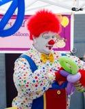 Clown making balloon animals Stock Image