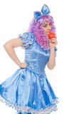 Clown in a Malvina suit with apple Royalty Free Stock Image