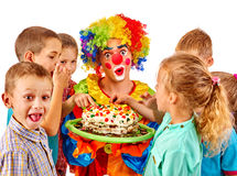 Clown man with kids holding cake on birthday Royalty Free Stock Image