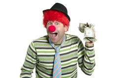 Clown with many dollar notes in hand Stock Images
