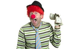 Clown with many dollar notes in hand. Clown with many dollar currency notes in hand humor funny business Royalty Free Stock Photography