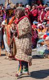 Clown with mask and costume in a traditional festival in Bumtha royalty free stock photography