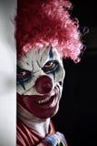 Clown mauvais effrayant images stock