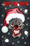 Clown mauvais effrayant de crâne dans le chapeau de Santa Photo libre de droits