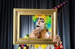 Clown med bildramar Fotografering för Bildbyråer