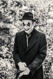 Clown med brandsläckaren Arkivfoton