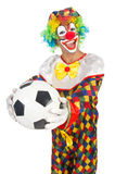 Clown med fotbollbollen Arkivbilder
