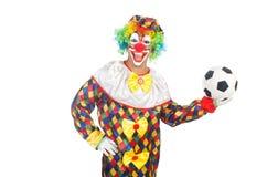 Clown med fotbollbollen Arkivfoto