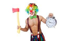 Clown med klockan och yxan royaltyfria foton