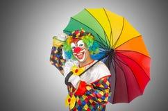 Clown med paraplyet Arkivbilder