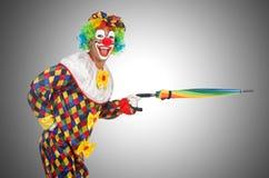 Clown med paraplyet Fotografering för Bildbyråer