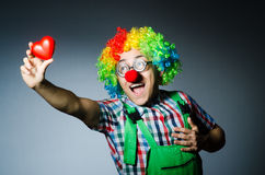 Clown med röd hjärta Arkivbild