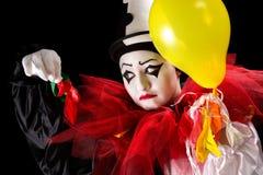 Clown med sprängda ballonger Royaltyfri Foto