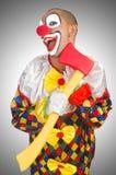 Clown med yxan Arkivbild