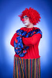 Clown men on blue background Stock Images