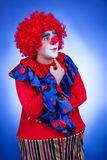 Clown men in circus outfit blue background Stock Photos