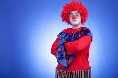 Clown men in red costume on blue background Stock Photo