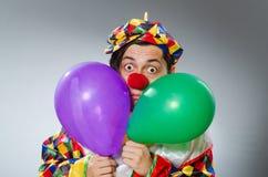 Clown met ballons in grappig concept Royalty-vrije Stock Foto's