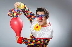 Clown met ballons in grappig concept Royalty-vrije Stock Afbeeldingen