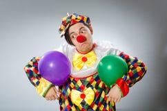 Clown met ballons in grappig concept Stock Foto's
