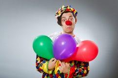 Clown met ballons in grappig concept Royalty-vrije Stock Fotografie