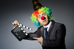 Clown met de film Royalty-vrije Stock Afbeeldingen