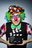 Clown met de film Stock Afbeeldingen