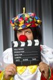 Clown met film Royalty-vrije Stock Afbeeldingen
