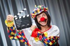 Clown met film Stock Afbeeldingen