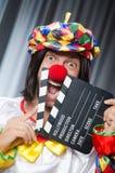 Clown met film Stock Foto's