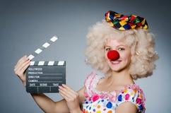 Clown met filmklep Royalty-vrije Stock Afbeeldingen