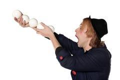 Clown met het jongleren van met ballen Stock Afbeeldingen