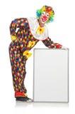 Clown met lege raad Stock Foto's