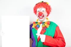 Clown met lege raad Royalty-vrije Stock Foto