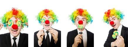 Clown met lolly op wit wordt ge?soleerd dat royalty-vrije stock foto