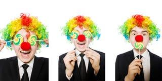 Clown met lolly op wit wordt ge?soleerd dat royalty-vrije stock afbeelding